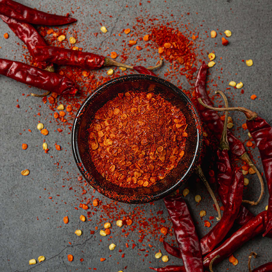 Red chilli paste on a black background.